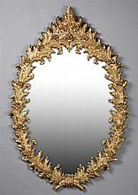 Gilt Wall Mirror, 20th c., by Turner Wall Accessories, the composition frame with relief flowers and leaves, H.- 51 1/2 in., W.- 34...