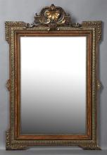 French Gilt and Gesso Overmantel Mirror, c. 1870, the arched pierced leaf crest over a relief frame, with relief tendril
