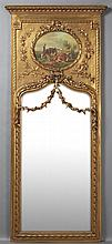 French Style Gilt Wood Trumeau Mirror, 20th c., the ogee crown over an oval oil of a milkmaid and cows, above an arched floral garla...