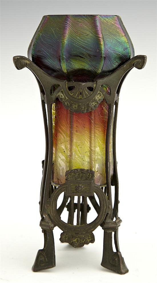 Loetz Style Iridescent Art Glass Vase, c. 1900, in a spelter stand, H.- 6 1/8 in., Dia.- 3 1/8 in.
