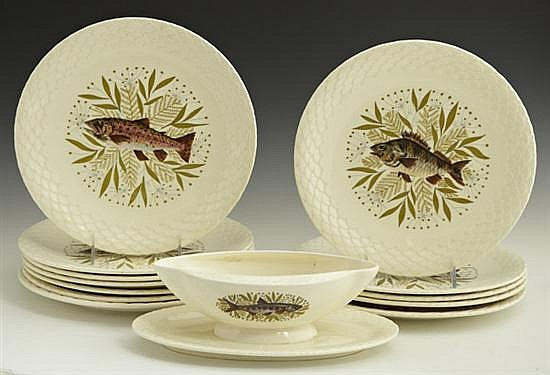 Thirteen Piece Ceramic Fish Set, 20th c., by Gien, consisting of 12 circular plates and a double lip sauceboat, each with transfer d...