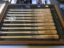 Display of 9 Signed Bats