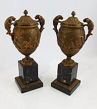 Pair of Empire style bronze urns on marble base