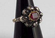 Rosette style diamond and ruby ring