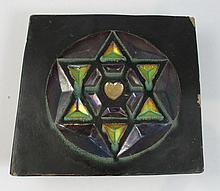 Zsolnay stove tile with the Star of David