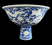 Fine blue and white glazed and anhua-decorated porcelain footed bowl. Ming dynasty, Xuande period.