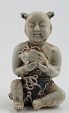 Chinese blue and white porcelain model of a child holding a fish