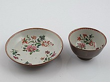 Pair of Chinese porcelain cups and saucers with floral decoration