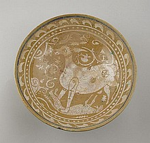 Persian ceramic bowl with stag defeating a leopard