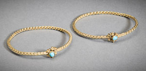Matched pair of Islamic gold bracelets set with turquoise cabochons