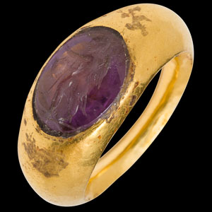 Early Eastern Roman gold ring with amethyst intaglio of winged Eros walking left