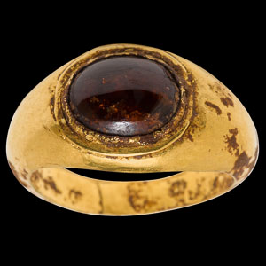 Imperial Roman gold ring with unengraved domed garnet cabochon