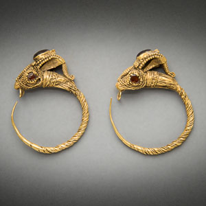 Rare large Hellenistic Greek gold ibex head earrings set with garnets