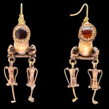 Imperial Roman gold earrings set with garnets, with amphora pendant drops