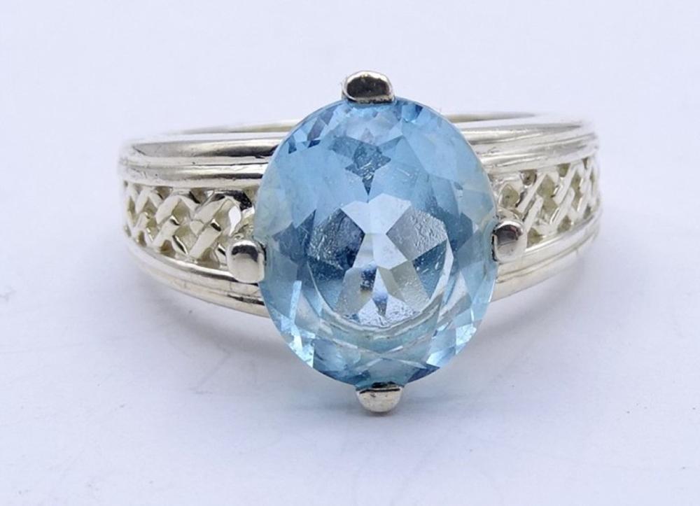 925er-Silberring mit hellbllauem fac. Stein, RG 60, 6,4 gr.