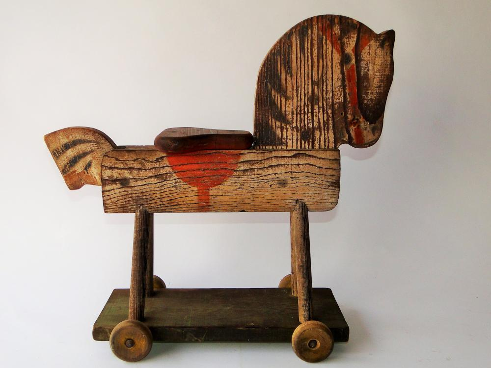 ANTIQUE RIDE ON  WOODEN PONY ON WHEELS