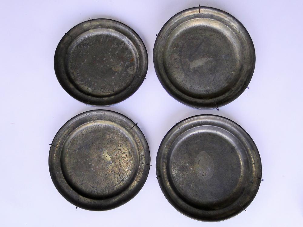 FOUR 18TH C PEWTER PLATES