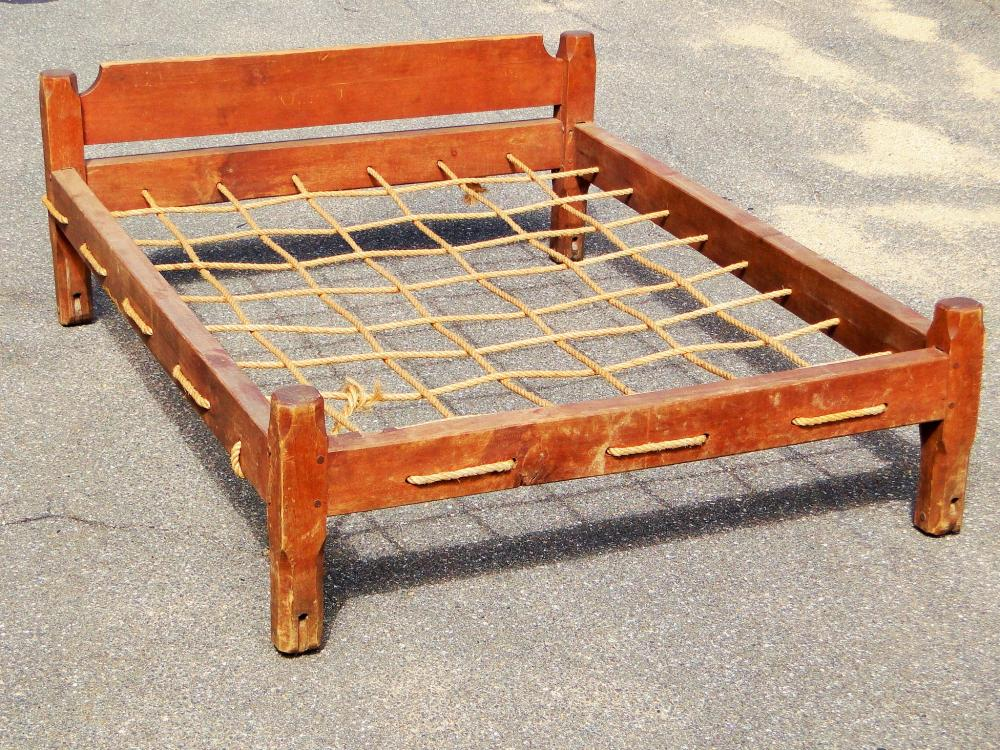 EARLY PAINTED TRUNDLE BED