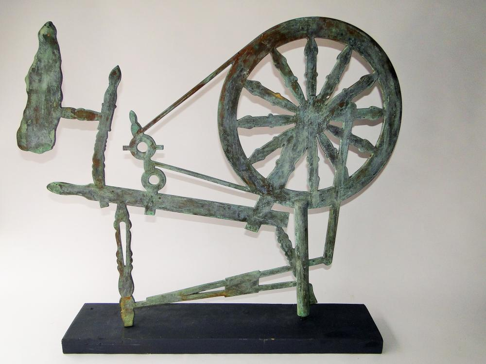WEATHERVANE OF A SPINNING WHEEL