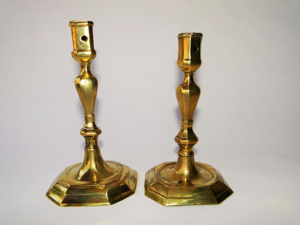 TWO EARLY 18TH C BRASS CANDLESTICKS
