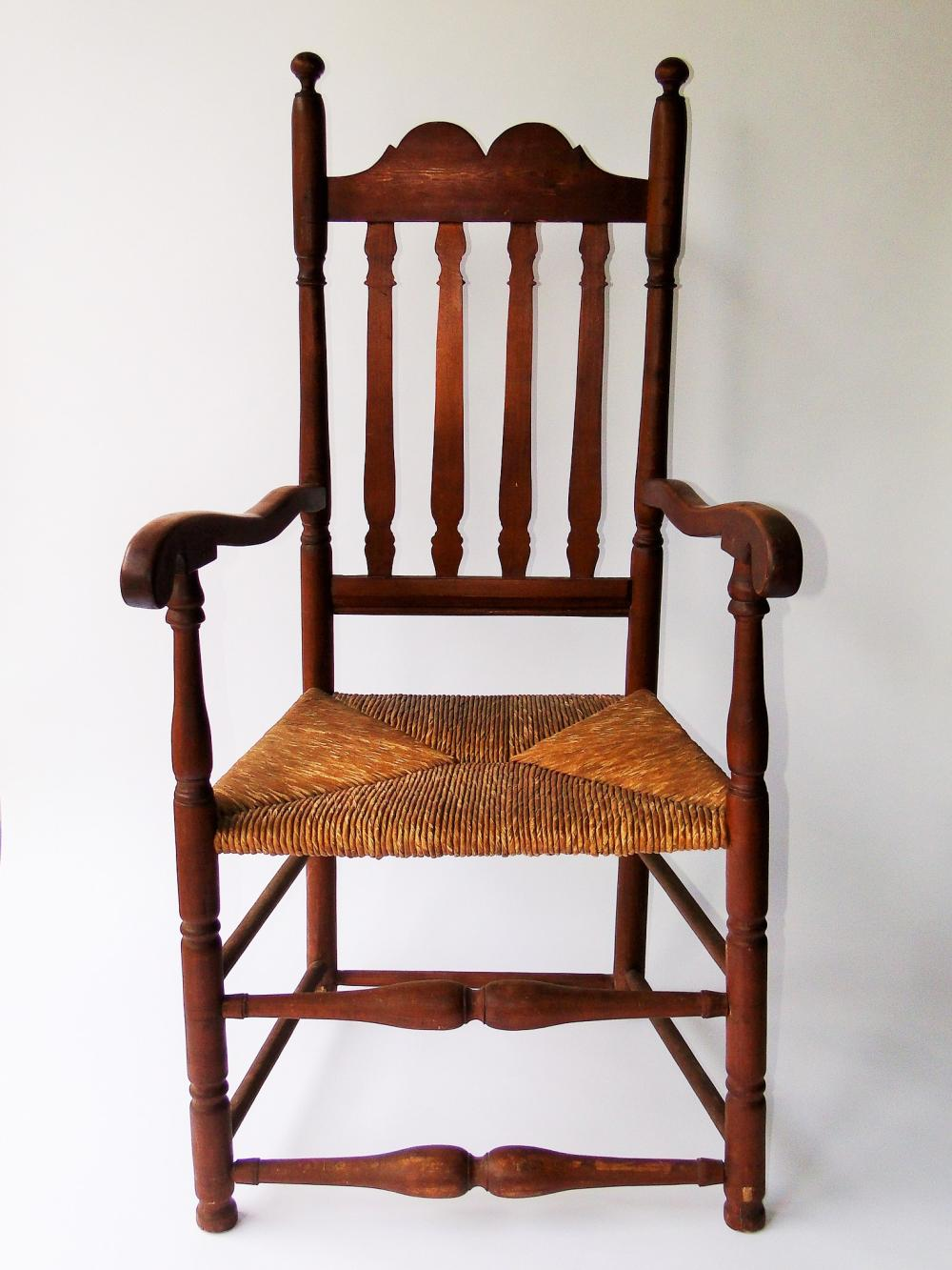 EARLY 18THC BANISTER BACK ARM CHAIR