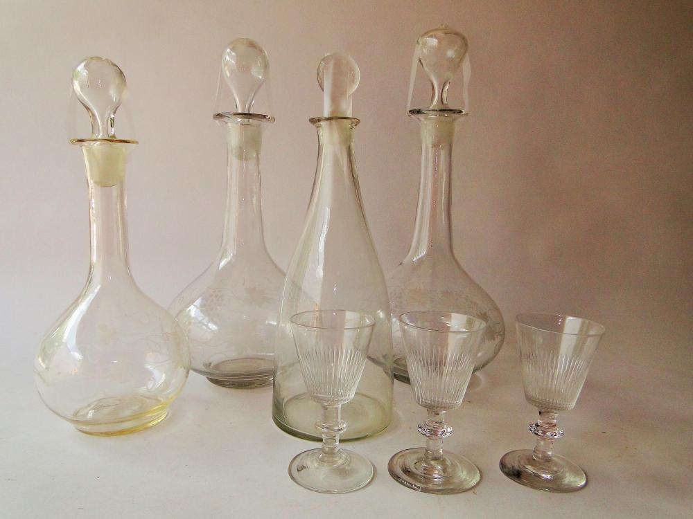 LOT OF FOUR GLASS DECANTERS