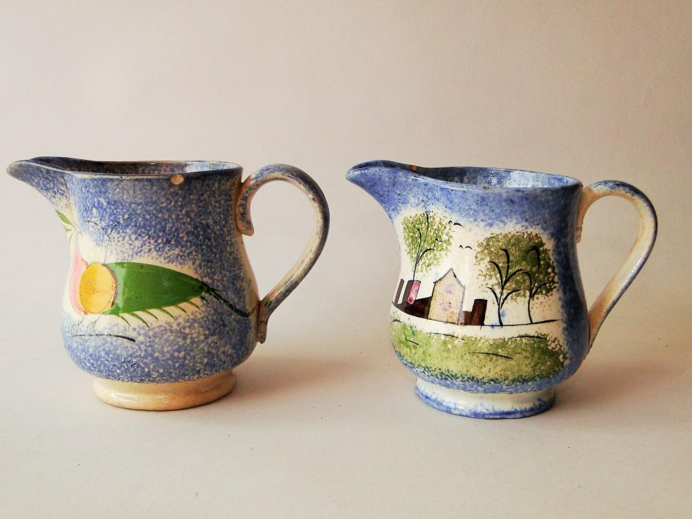 TWO 18TH C SPATTERWARE CREAMERS