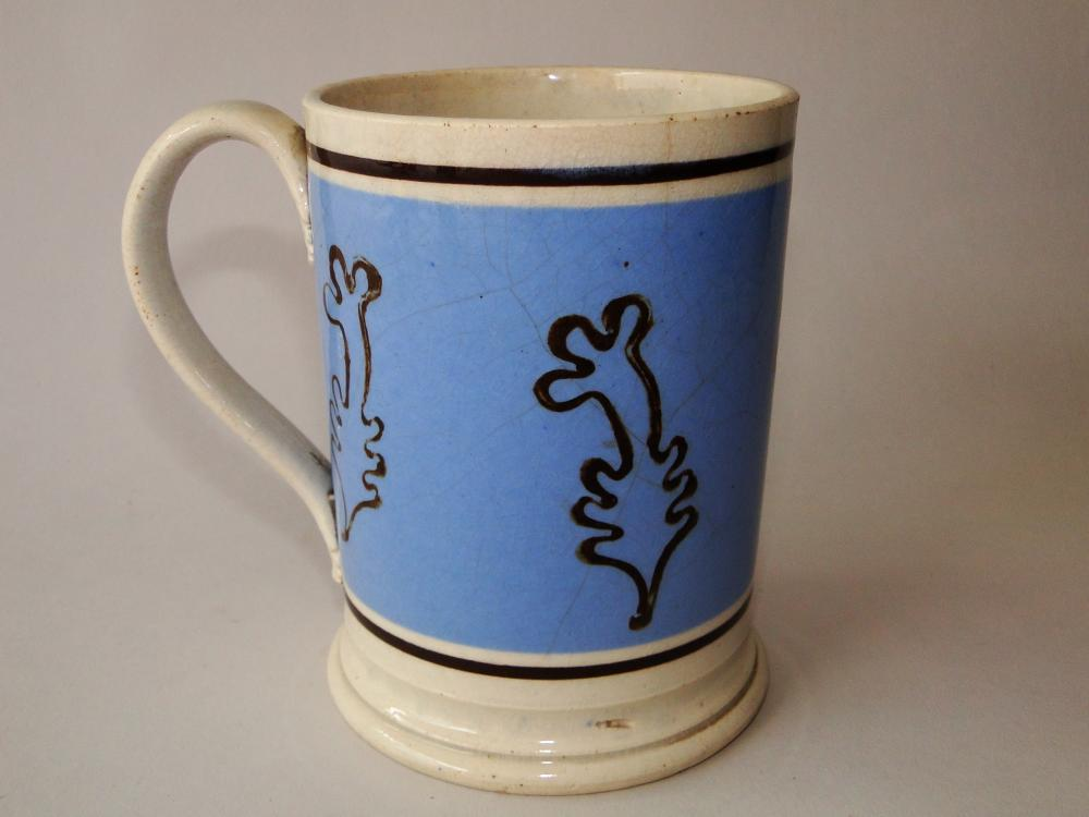 Lot 144: 18TH C MOCHAWARE TANKARD SLIP DECORATION