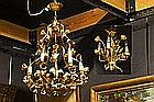 two small chandeliers in guilded wrought iron