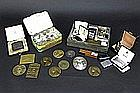 several lighters and medals in bronze