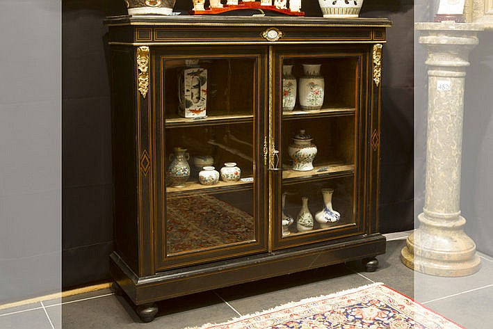 19th Cent. Napoleon III-display cabinet in ebony with a small plaque in porcelain