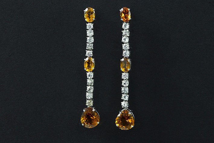 very elegant pair of earrings in white gold (18 carat) with 1250 carat of gold topazes and sapphires