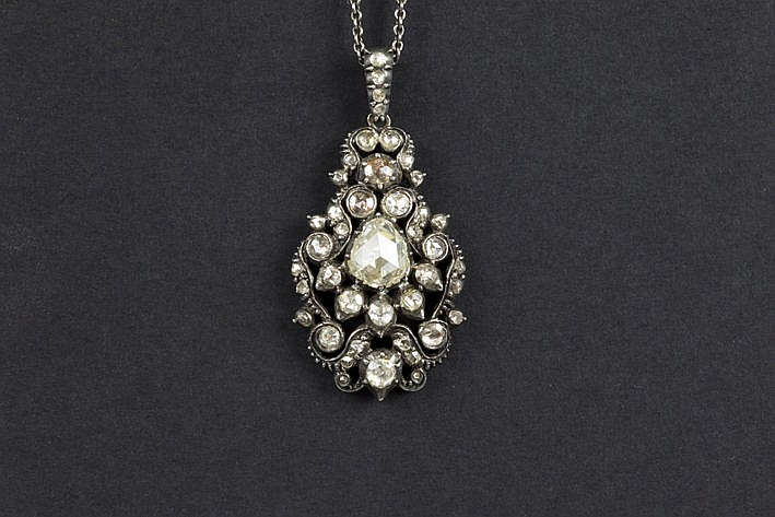 early 19th Cent. pendant in silver and gold with rose cut diamonds (the middle one measures 8 mm) - with a chain in silver
