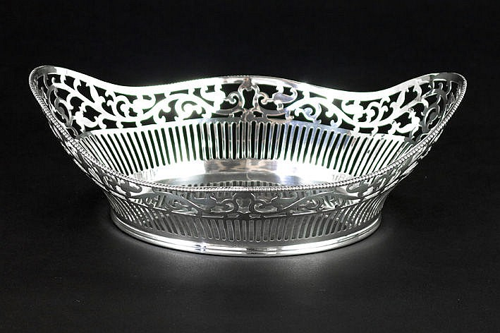 oval neoclassical basket in marked silver