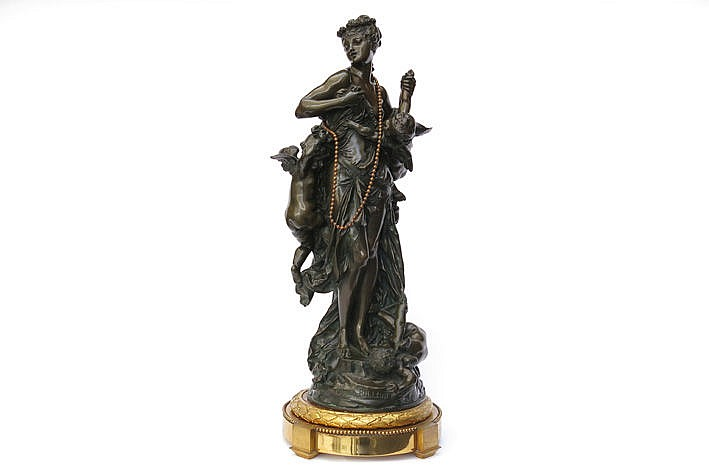 antique sculpture in bronze on its base in guilded bronze - signed and dated