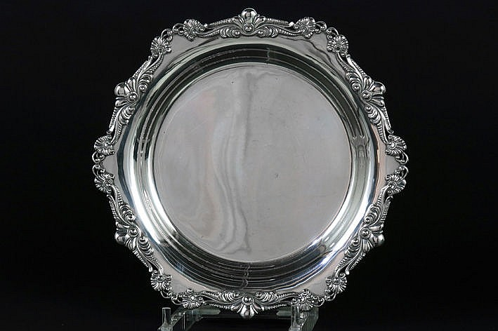 dish with baroque border in marked silver