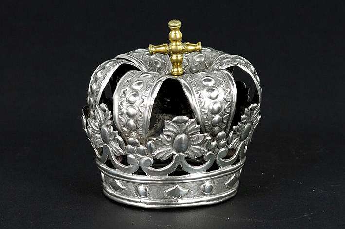small antique crown in silver