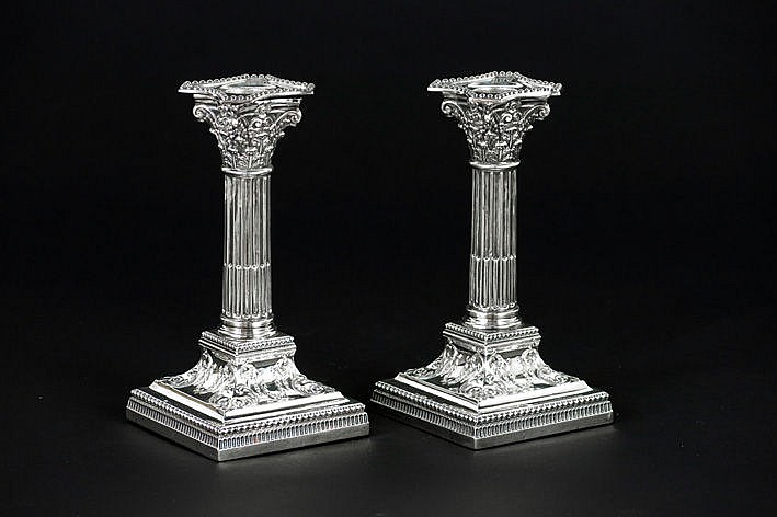 pair of (�) antique candlesticks in marked silver - signed