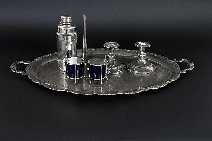 several silverplated items on a big tray