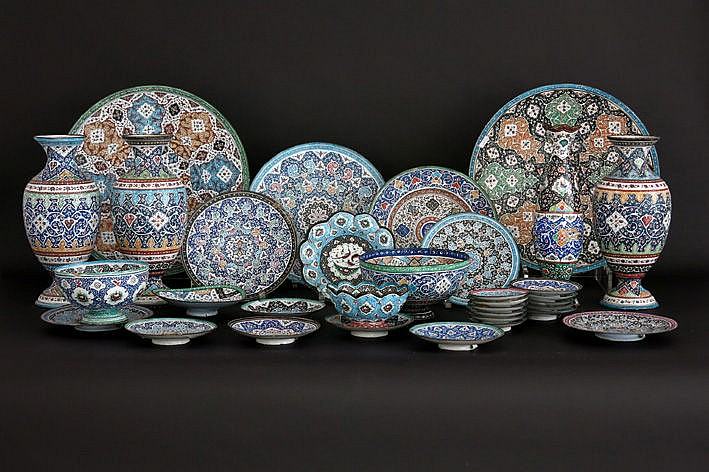 several Persian small plates dishes and bowls in enamelled metal