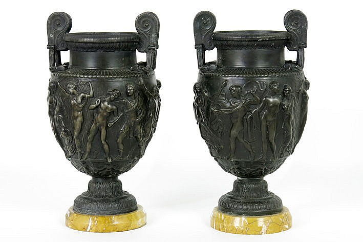 pair of (�) antique urn-shaped handles in zamac with bas-reliefs with mythological friezes - on marble base