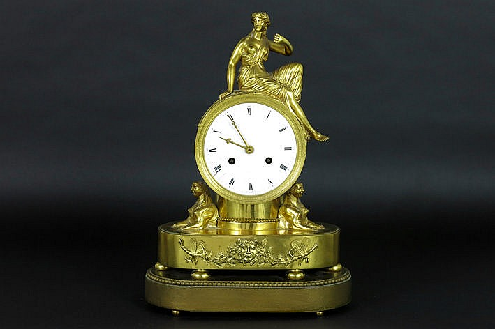 antique neoclassical clock with case in guilded bronze