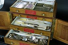 cutlery case with two small doors and with drawers filled with cutlery in silverplated metal and silver