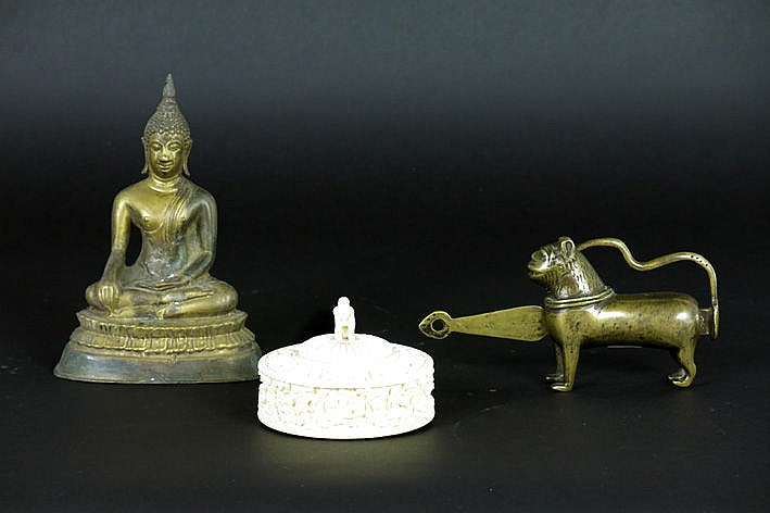 lot (3) with a small signed lidded box in ivory a small Thai Buddha statue and a lock/clasp in Indian brass in the form of a little lion