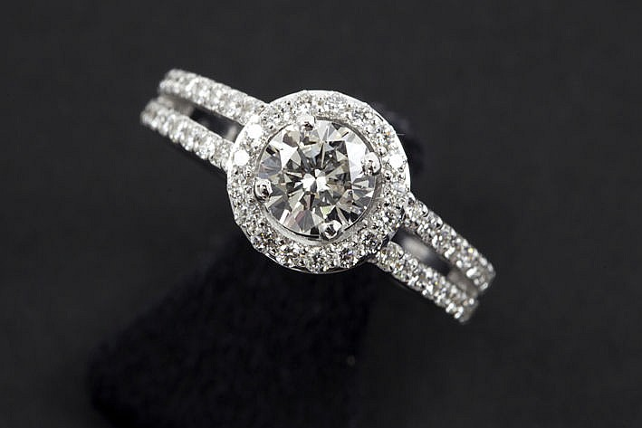 high quality brilliant of ca 080 carat set in a stylish ring in white gold (18 carat) with ca 060 carat of very high quality brilliant