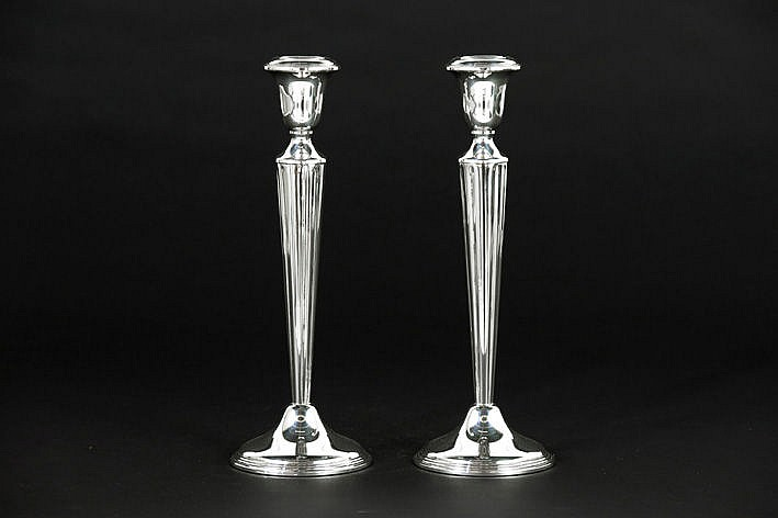 pair (�) of Art Deco candlesticks in marked and signed silver