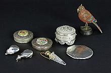 several pill boxes and a Tibeto-Nepalese sculpture
