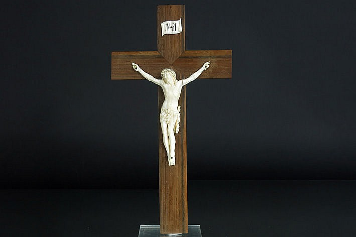 antique corpus in ivory on a wooden crucifix marked on the back