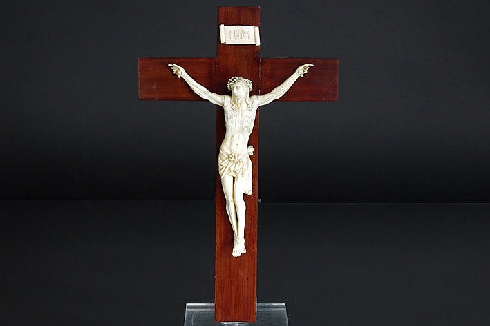 antique European sculpture in ivory on a wooden cross