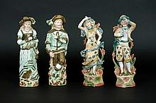 two pairs of figures in colored biscuit